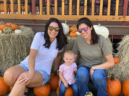 little girl and ladies and pumpkins GREAT AMERICAN LONE STAR RANCH