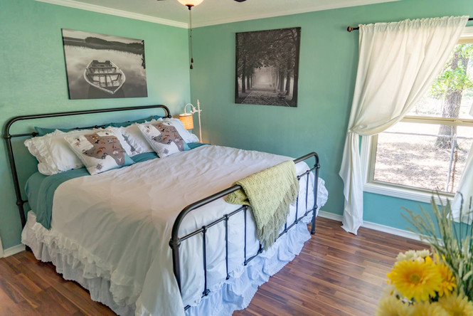 Beautiful master bedroom with king size bed
