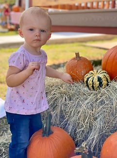 little girl and pumpkins GREAT AMERICAN LONE STAR RANCH