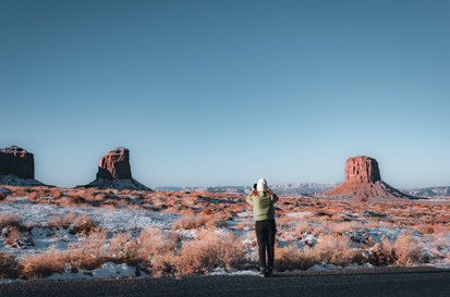 monument valley lookout with girl and snow