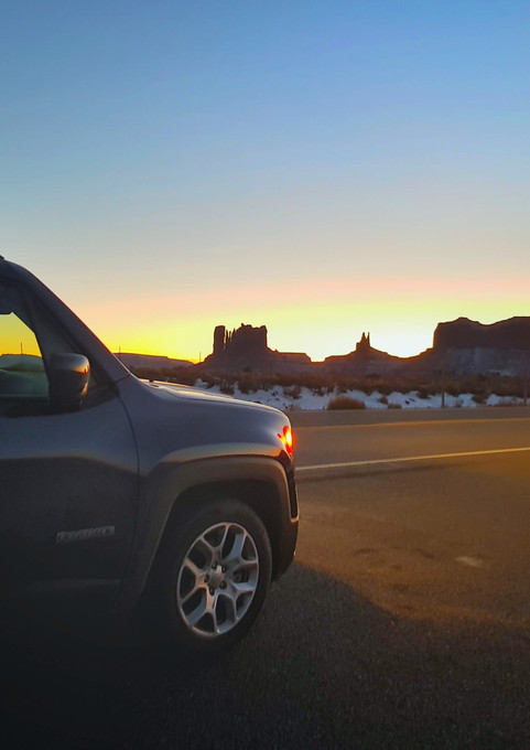 Jeep Renegade in Monument Valley sunset