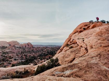 photographer in canyonlands overlook the valley