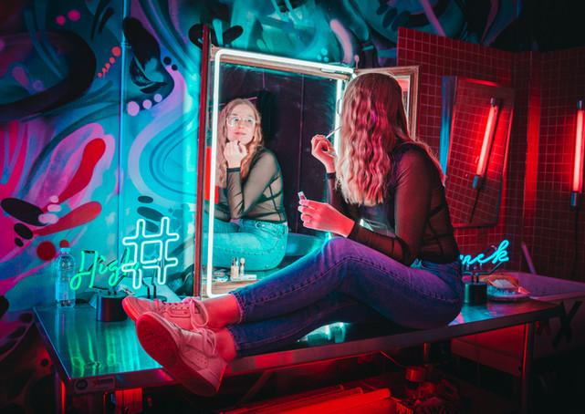 Neon photoshoot - girl makeup mirror hashtag