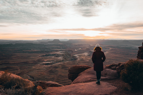girl in sunset Canyonlands photography lookout