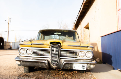 Vintage yellow car near route 66 photography