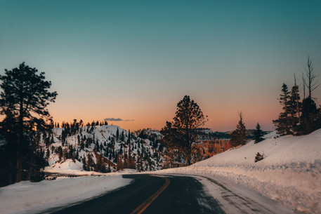 sunset on a snowy road winter photography