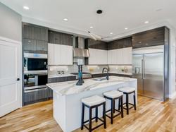 Kitchen with waterfall edge island.