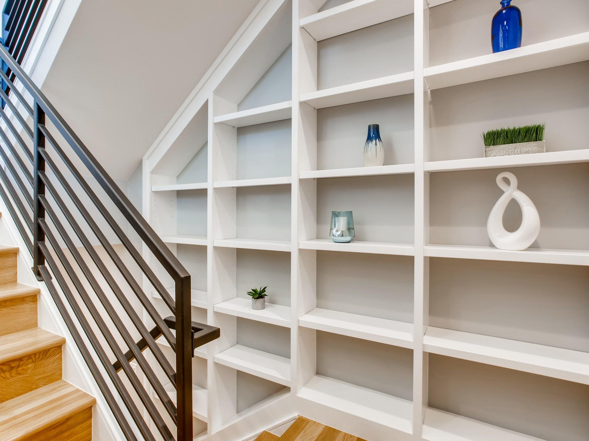 Built-in bookshelves in stairs.