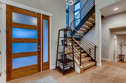 Entry with open tread stairway