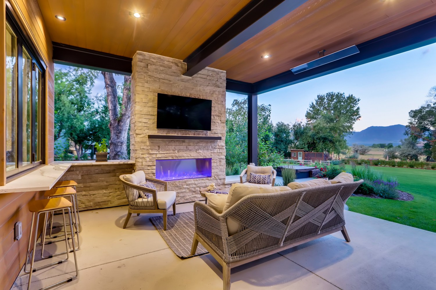 Outdoor living with fireplace and TV