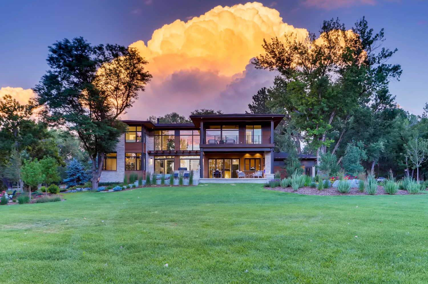 Rear of custom home with storm clouds