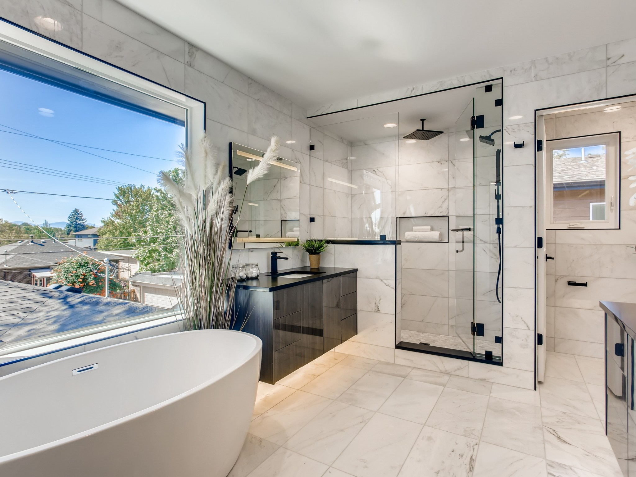 Spa inspired Master Bath with Steam shower and freestanding tub.