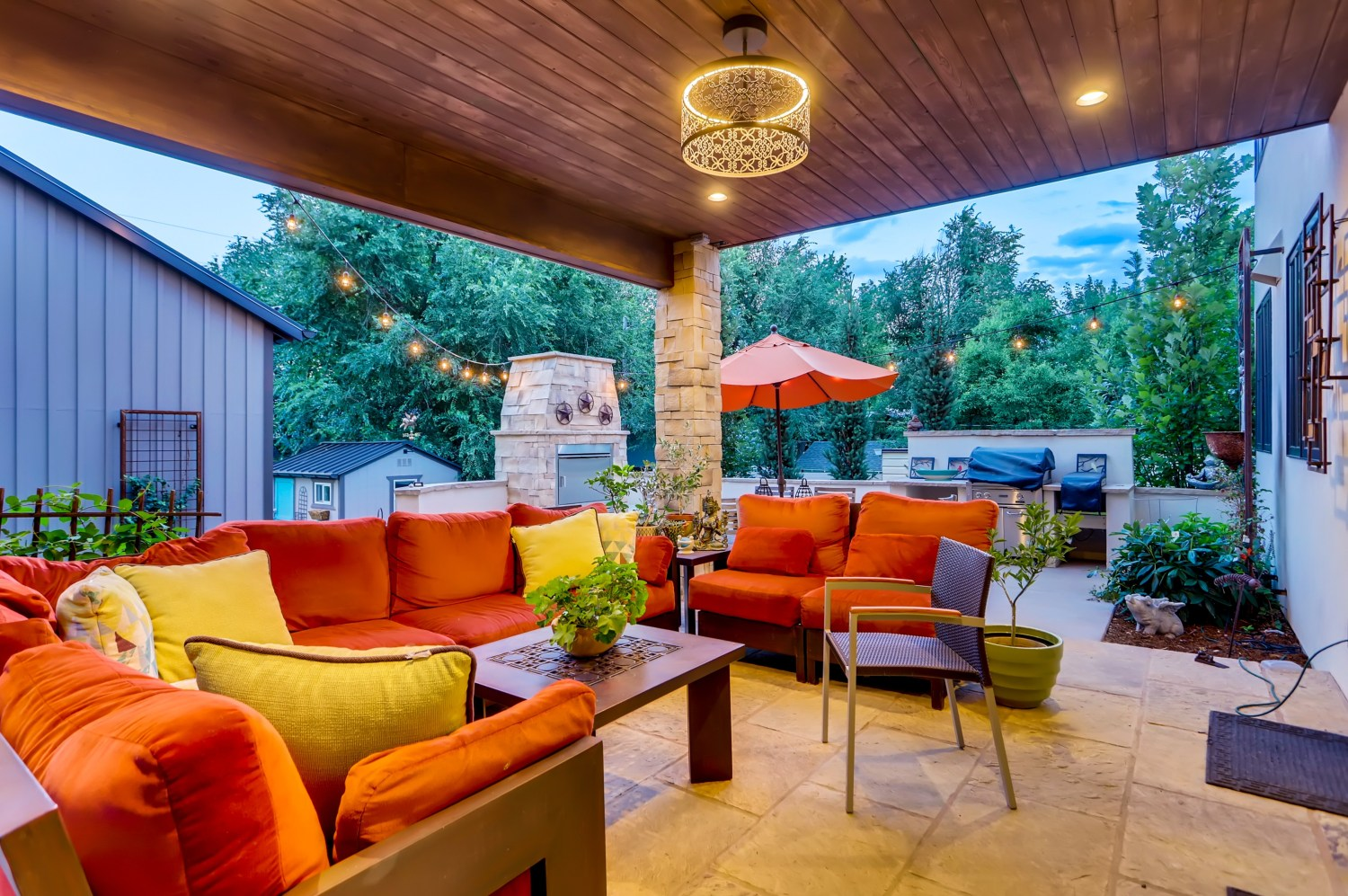 Covered rear patio with chandelier.