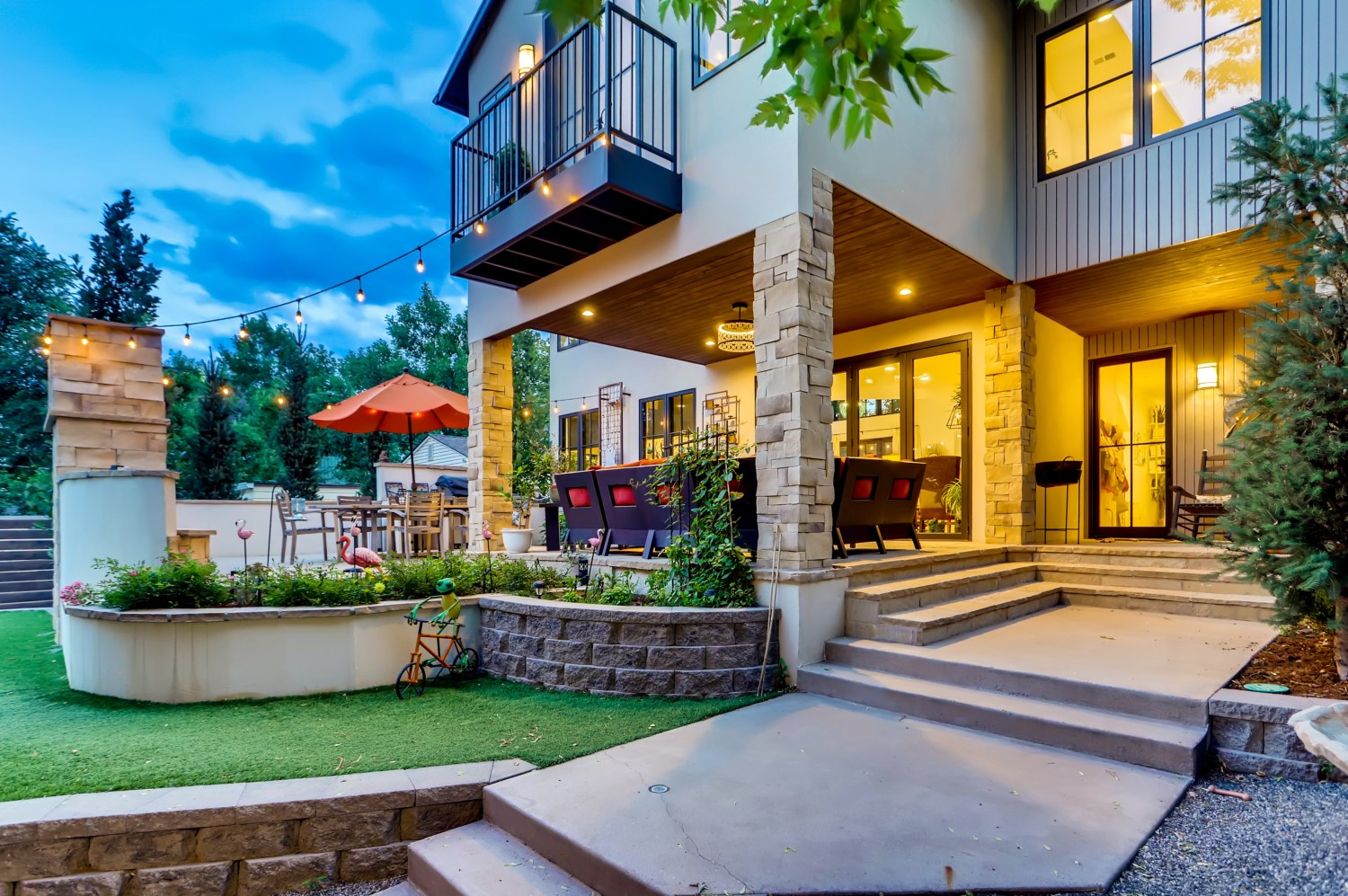 Rear outdoor living with covered patio.