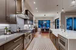 Kitchen with nook beyond