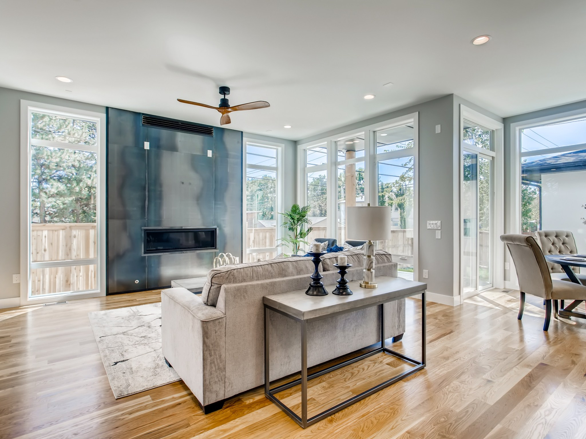 Great room tall ceilings with floor to ceiling windows
