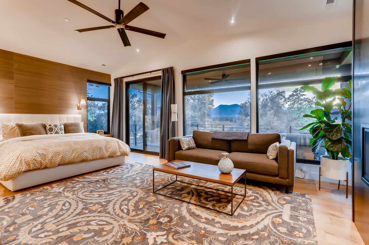 Master bedroom with large windows to Western views.