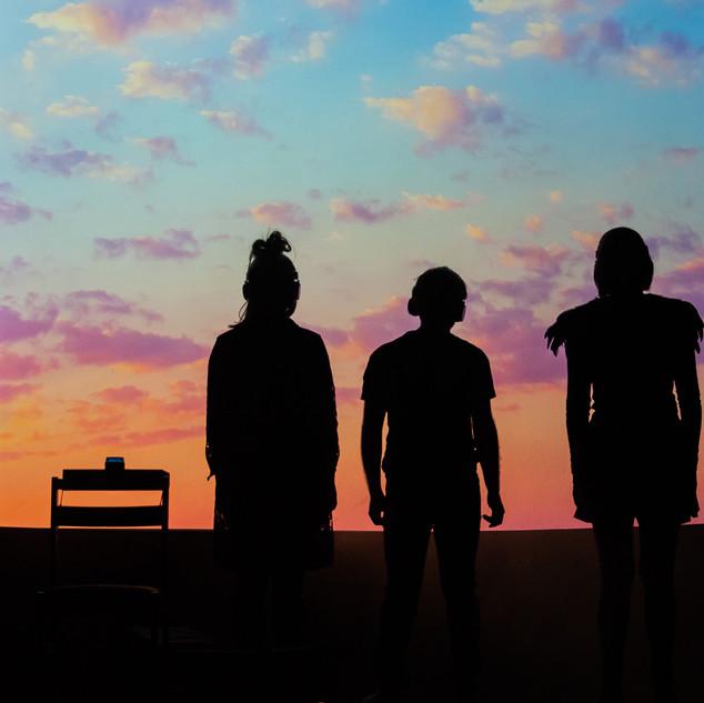 Image Description: Laura, Michel and Karen watching the sunset.