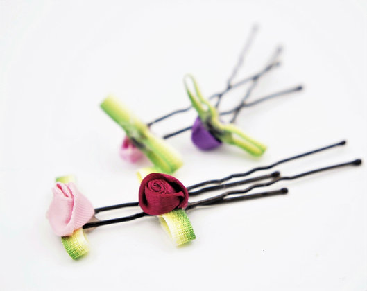 pink and purple floral hair pins