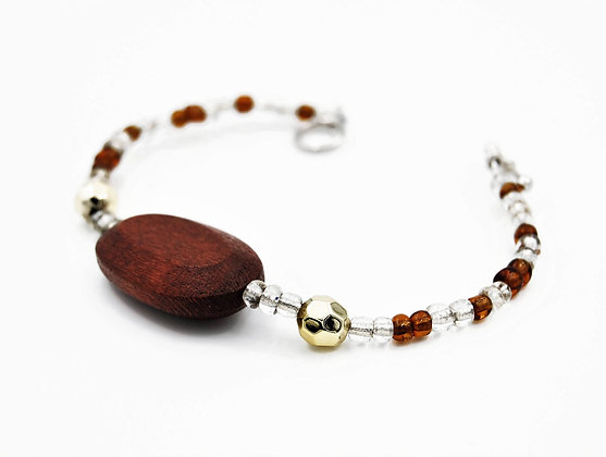 Amber brown bead bracelet with large wood focal bead and toggle clasp