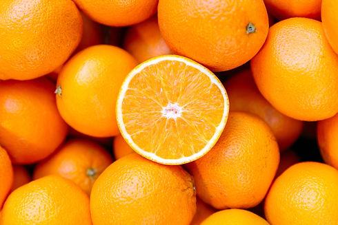 half-of-orange-on-the-heap-of-oranges-ro