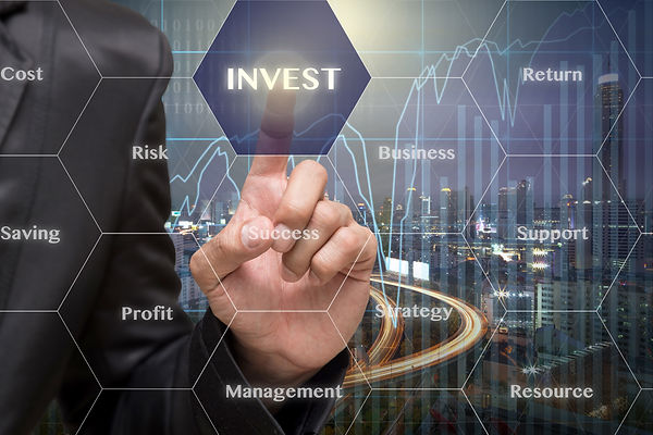 Businessman touching the Invest icon wit