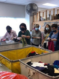 GT Volunteers Sort Clothes at Interfaith Works