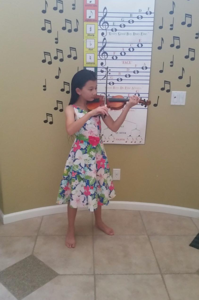 Jade playing violin