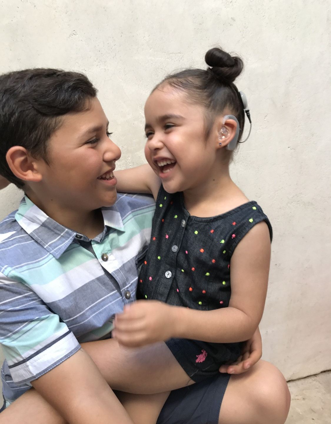 Happy siblings with hearing loss