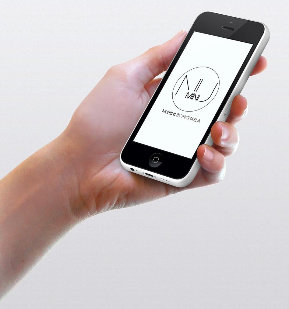 iPhone-mockup-hand-by-GWENO-v2.jpg