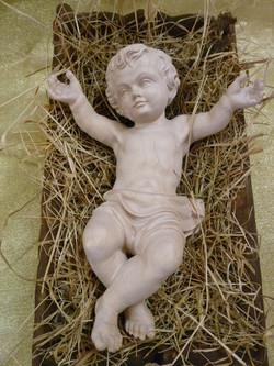 Jesuskind gross in Krippe, natur/roh