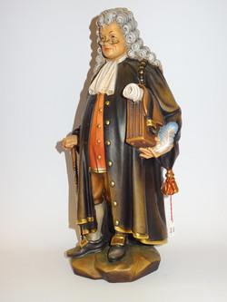 Jurist aus Holz geschnitzt