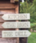 wooden handpainted signs at The Keeper and the Dell