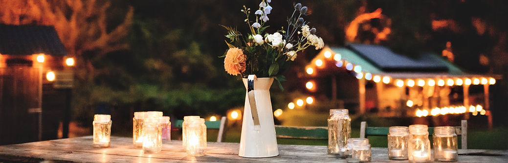 vintage styling, festoons, candlelit, florals at outdoor wedding venue, The Keeper and the Dell