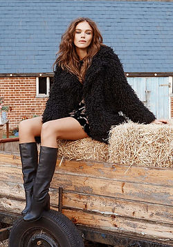 Urban Outfitters Photoshoot Straw bales, trailer, barn, bohemian model, fur jacket The Keeper and the Dell, Norfolk