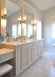 bath cabinetry, marble floors, tub, lights