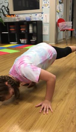 Yoga art and dance event student doing C