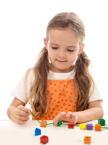 child-playing-with-beads.jpg