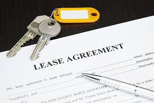 Lease agreement document with keys and p