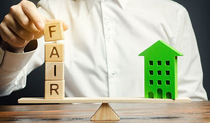 Wooden blocks with the word Fair and a w