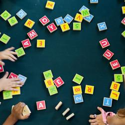 kindergarten-kids-playing-wooden-alphabe