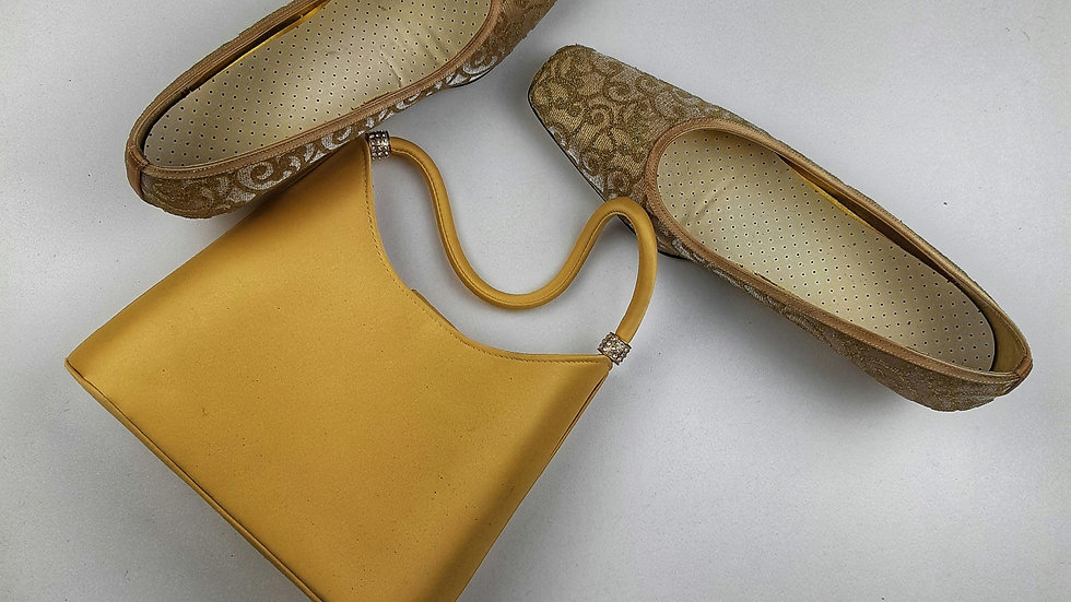Gold hand bag. with rope to convert to shoulder bag.