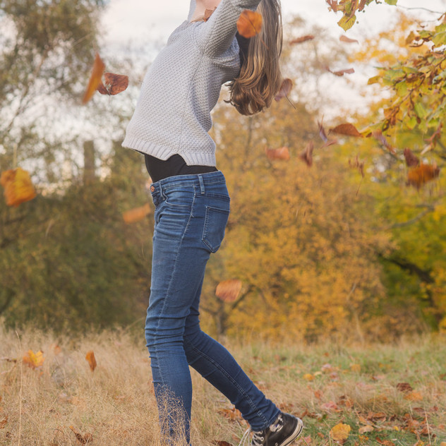 kids photo session in autumn, in a london park. Throwing leaves in the air!