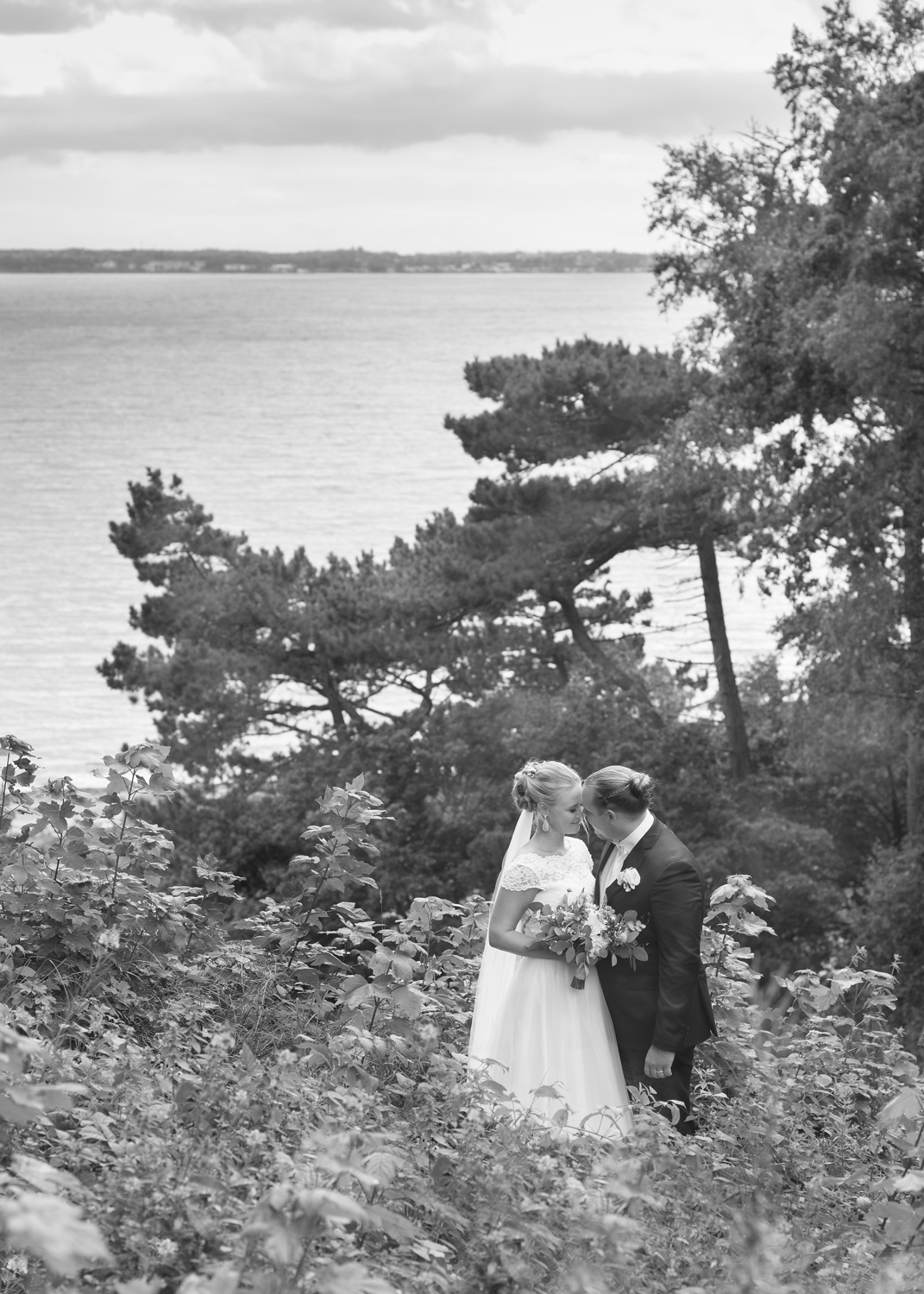 bride and groom overlooking the sea