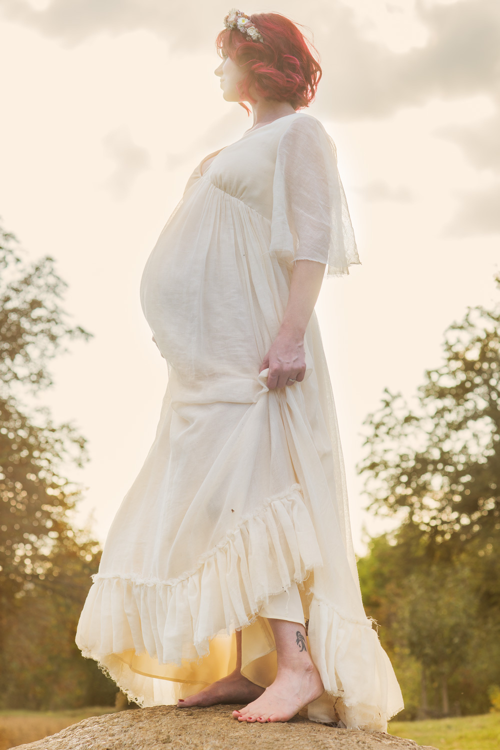 Outdoors portrait of pregnant woman.