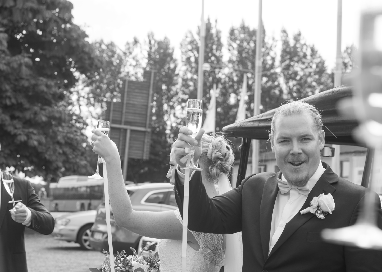 bride and groom cheer with champagne
