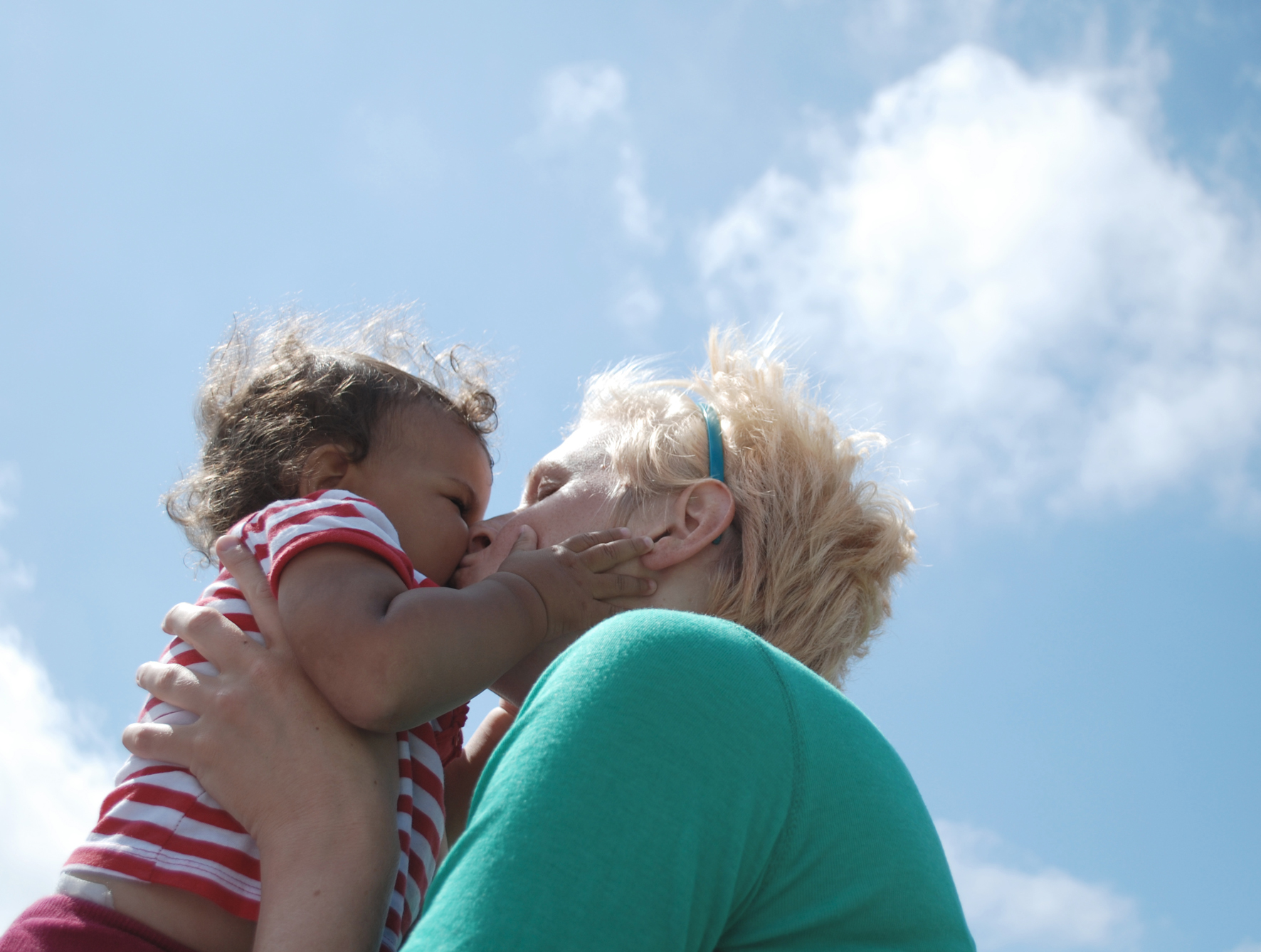 Outdoor portrait of baby and mum