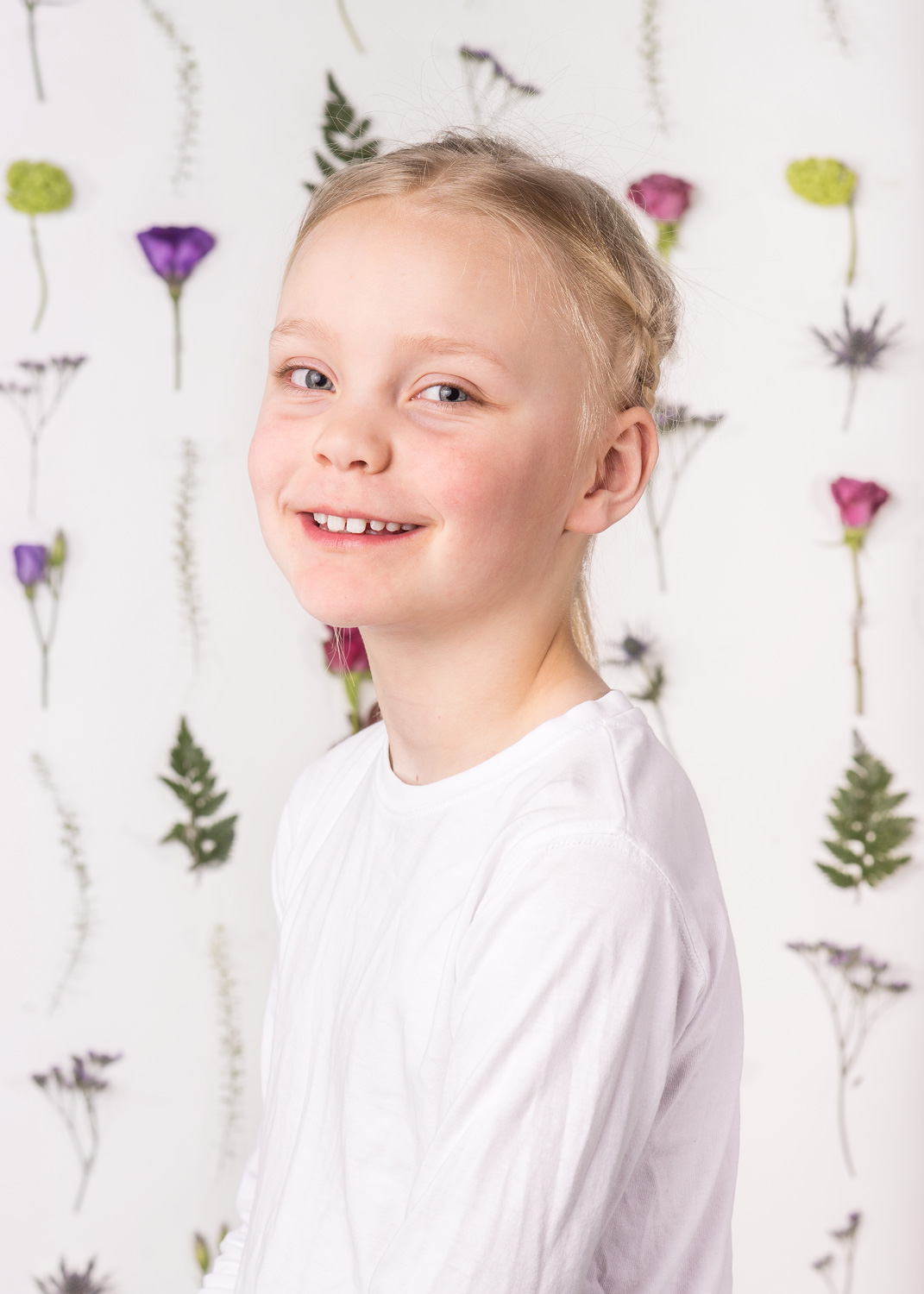 floral backdrop portrait of girl.
