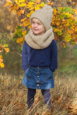 Barnfotografering utomhus på hösten