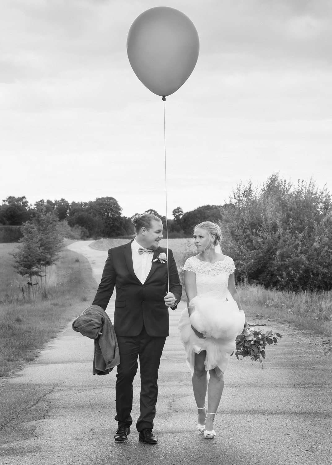bride groom on path with balloon